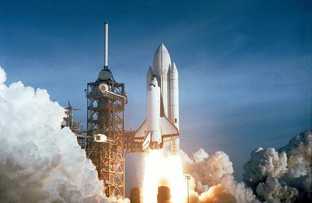 The April 12 launch at Pad 39A of STS-1, just seconds past 7 a.m., carries astronauts John Young and Robert Crippen into an Earth orbital mission scheduled to last for 54 hours, ending with unpowered landing at Edwards Air Force Base in California