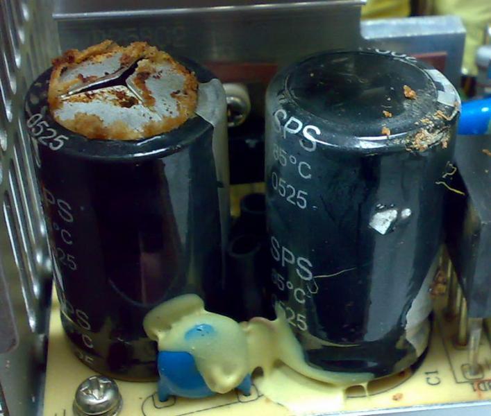 Вздутые конденсаторы блока питания с неприятного вида потеками